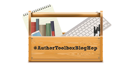 "A photoshopped image of a wooden toolbox which has a notepad, five books, an iphone, a mac keyboard, and three black pens inside of it. On the front of the toolbox is written ""#AuthorToolboxBlogHop"""